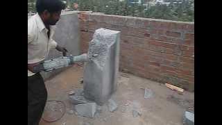 Tritherm-Rcc concrete demolishing by Hitachi PH 65 Breaker/demolition hammer machine