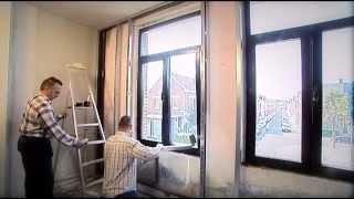 Een geïsoleerde voorzetwand met dampscherm plaatsen aan een buitenmuur