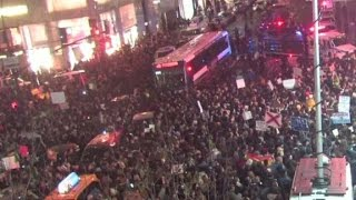 Crowds gather to protest outside Trump Tower