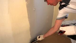 Spackling an uneven wall -- step by step