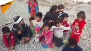 بالفيديو... الرعب يلاحق أطفالا عراقيين هاربين من