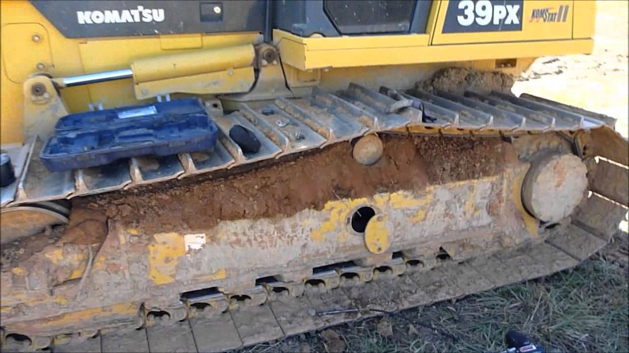 medium resolution of tensioning the dozer tracks