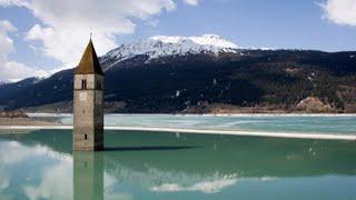 Alto Adige, svuotato il lago di Resia: riaffiorano i resti del borgo sommerso di Curon