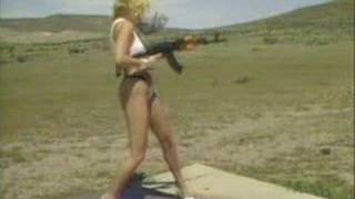 Woman with her ak47 ( ak74 ( AKMS ))  advertisement propaganda taliban baby