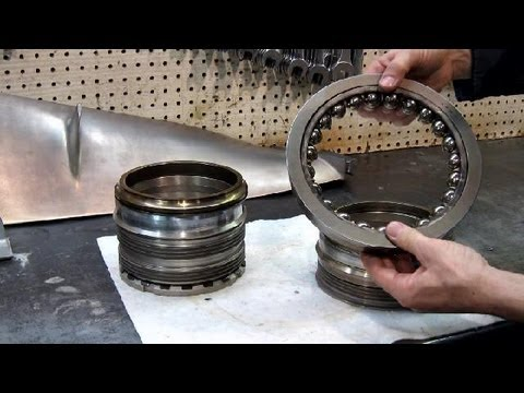 the Thrust Bearing: what holds it in?
