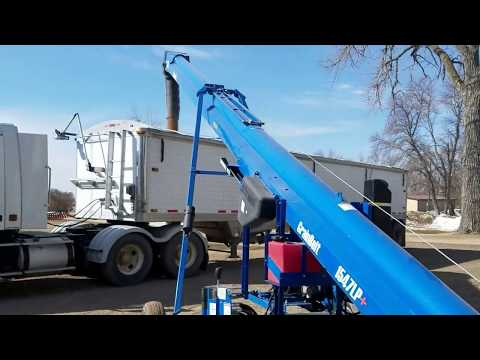 Loading out wheat Brandt Grainbelt 1547LP+