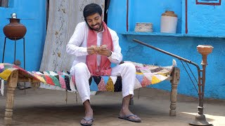 Attractive Indian villager taking a phone-call about receiving money - financial concept