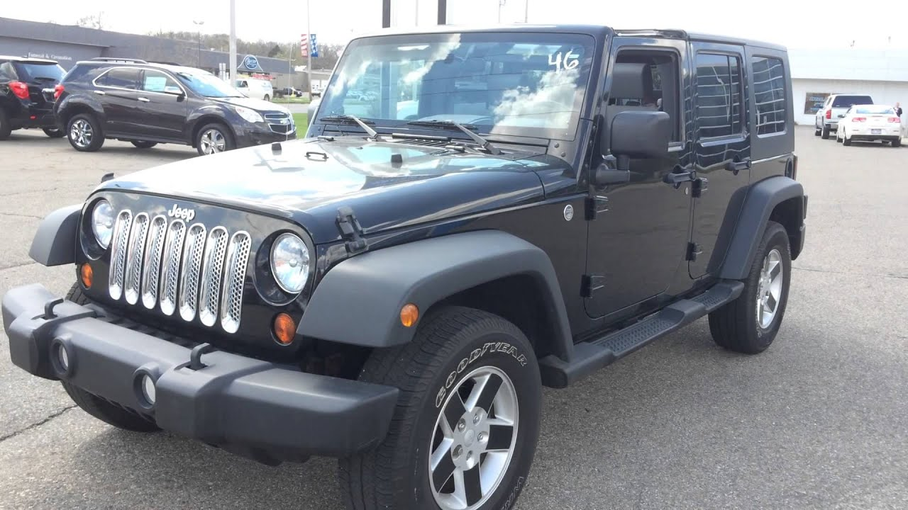 2010 jeep wrangler unlimited 4 door sport 4x4 black w hard top call text paul at 269 223 0875. Black Bedroom Furniture Sets. Home Design Ideas