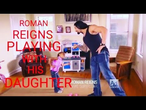 Roman Reigns playing with his daughter