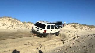 snatch strap rescue jeep grand cherokee wj and a bogged triton