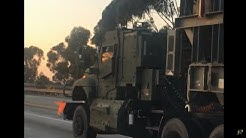 Armored Military Semi Hauling Odd Equipment On 405 North In Southern California