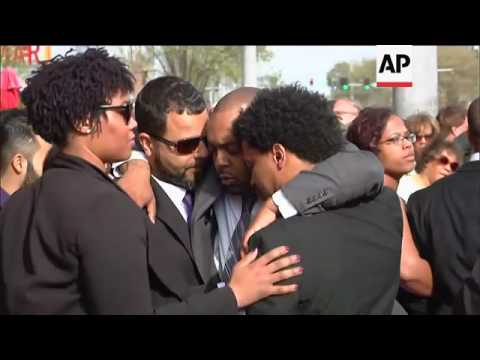 Fans and mourners gather on street after Chuck Berry's service