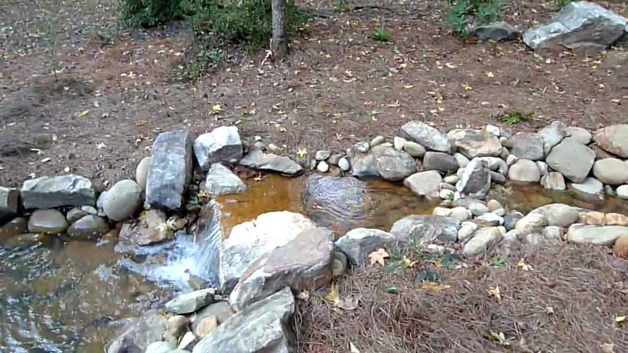 Backyard stream waterfall and pond youtube for Building a waterfall and pond