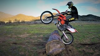 How to jump logs on a dirt bike using punch technique - Enduro Riding Training.
