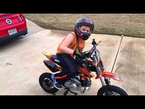 They're racing Dirt bikes in the yard for money!! - YouTube