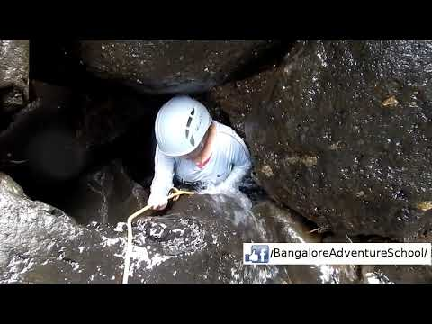 Nethra Rappelling into a cave waterfall in Sandhan Valley Canyon