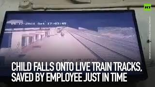 Child falls onto live train tracks, saved by employee just in time