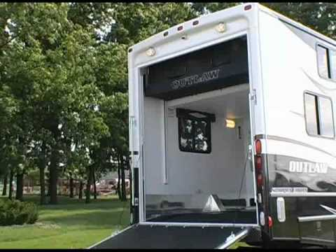 Review of damon motor coach 39 s outlaw motorhome exterior for Rv with garage