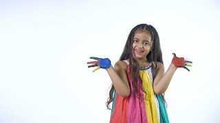A young funny artist happily smiling with painted hands against the white background