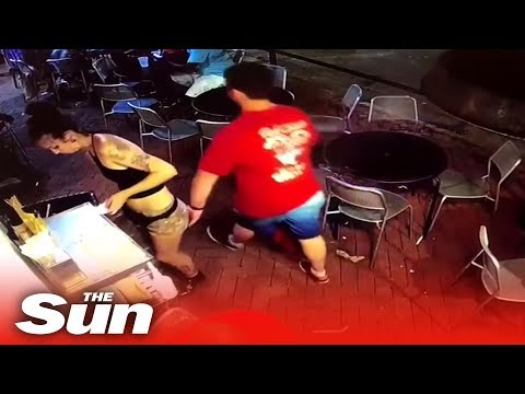 Waitress tackles customer who SLAPS her bum