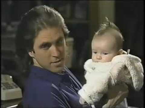 Allan Havey talks to a baby Liam Aiken