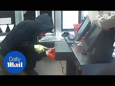Burglar breaks into a KFC drive-thru before robbing the register