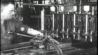 During World War I, workers manufacture automatic rifles at a factory in the Unit...HD Stock Footage