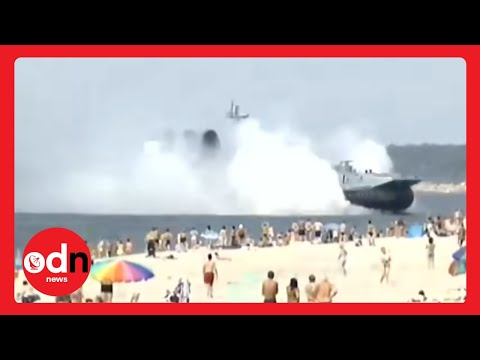 Amazing video of Russian military ship ploughing onto a crowded beach