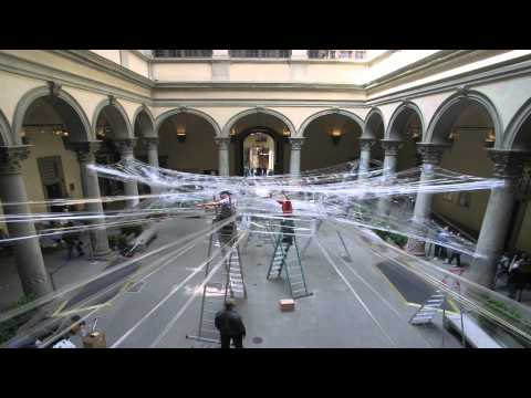 A Super-Sized Cocoon Made of Packing Tape That You Can Curl Up In