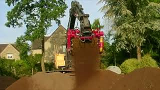 Rotastar 6 screening bucket screening topsoil to a 20 mm grade  Movie