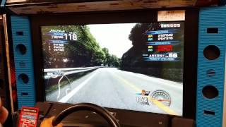 My girlfriend's brother playing some Initial D 6 AA at the arcade i...