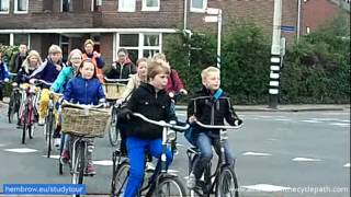 School trips by bicycle. An everyday occurrence in Assen, Netherlands. True mass cycling thumbnail