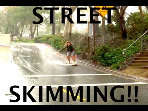 Skimboarding in the Street during a Rainstorm!