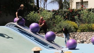 Yoga Ball Surfing Down a Slide!