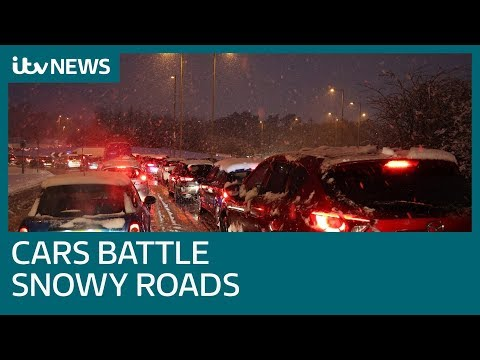 Cars battle 'virtually impassable' roads as 17cm snow recorded | ITV News