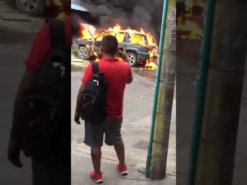 Cort Webber - Burning car explodes while people record it