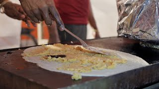 Time lapse shot of dosa preparation at the street side food stall