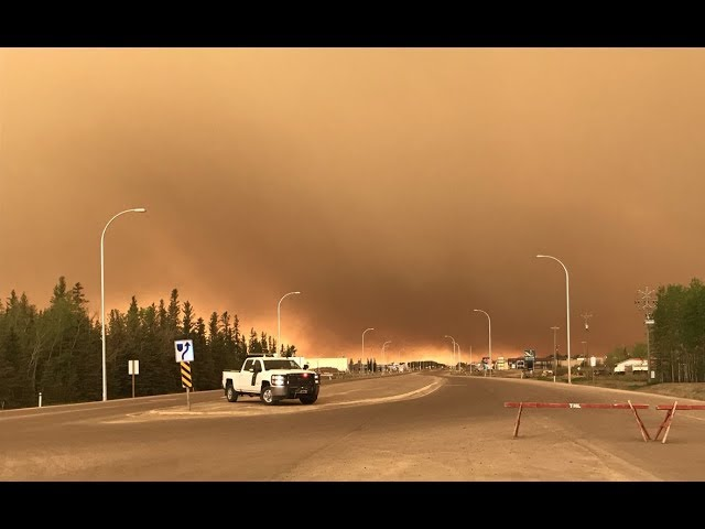 Thousands displaced by wildfires in Alberta, northern Ontario