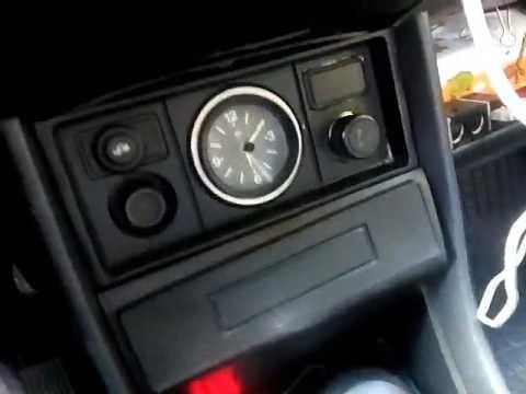 Сигнализация низкого уровня тормозной жидкости и включенного ручника.