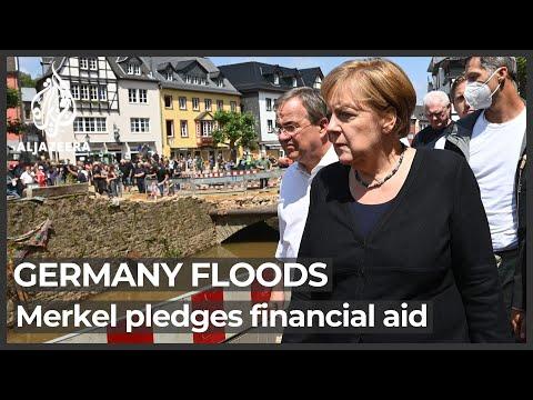 Merkel promises quick aid as Germans struggle with flood havoc