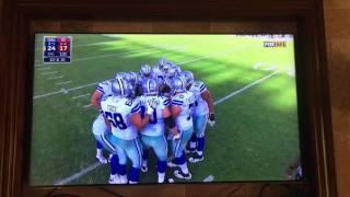 Dallas Cowboys Zack Martin gives a little skeet skeet in the huddle