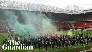 'Glazers out': Manchester United fans take to Old Trafford pitch during protest