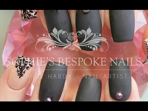 Acrylic Nails With A Matte Black & Nude Nail Design