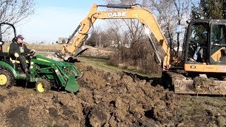 trench-collapses-compact-tractor-and-case-excavator-try-to-dig-geothermal-loop