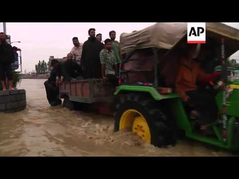 Floodwaters submerge large parts of city in Indian-controlled Kashmir