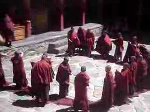 Young Buddhist Monks in Tibet Struggle with Their New Robes