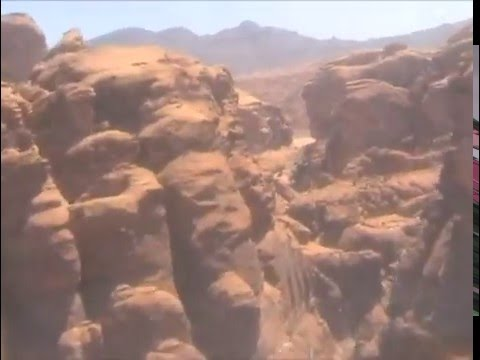 Cockpit footage of a hawk fighter jet flying low through canyons in Saudi Arabia