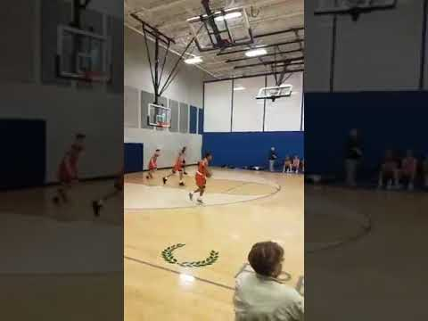 Elkhorn (EAA) 8th grader (omaha NE) hits an amazing half court buzzer beater to end the first half