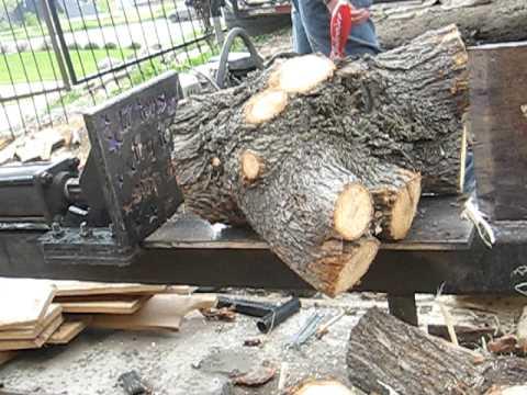"""logsplitter splits 12"""" oak with 5 h.p. engine log has 9 knots in it"""