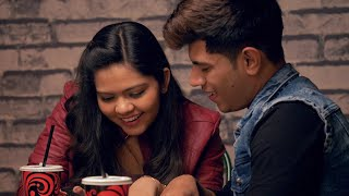 Cute Indian couple laughing while watching videos in a cafe - happy moment. Valentine Day